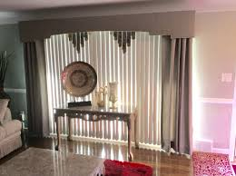 deco fabric wrapped cornice board with dry panels over vertical blinds