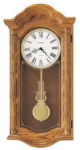 arched bonnet oak dual chime wall clock 620222 howard miller