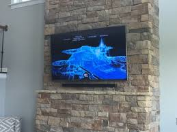 charlotte flat screen tv installation on stone or brick fireplace in charlotte nc tv mounting