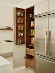 contemporary kitchen ideas. Photo Of A Large Modern Kitchen Pantry In London With Flat-panel Cabinets, White Contemporary Ideas
