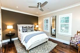 bedroom with brown walls brown accent wall bedroom inspired bed in bedroom transitional with wall fan bedroom with brown walls