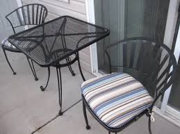 interesting black metal patio furniture outdoor chairs design featuring with striped pattern padded seat cushion and