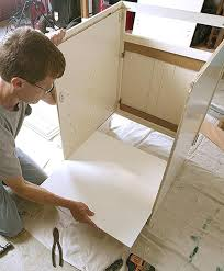 fitting ikea kitchen cabinets to wall assembling cabinet article image fitting ikea kitchen cabinets to wall assembling cabinet article image