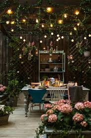 amazing garden lighting flower. The Best Outdoor Lighting And Decor For Summer | Cuprinol Dining In Garden With Floating Lights Amazing Flower