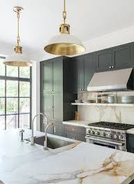 classic style townhous by elizabeth roberts marble kitchen backsplash and counter and dark green cabinets