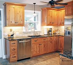 rustic knotty alder kitchen with weathered beams