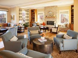 This spacious living room is divided into several sitting areas, including  one anchored by a