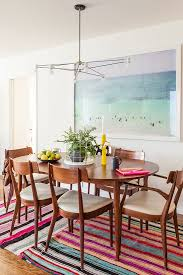 designlovefest layered rugs giant beach print by max er vine kilim danish modern chairs retro style find this pin and more on fine dining