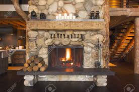 rustic fireplace in log cabin stock photo 3714384