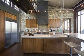 modern kitchen design with track lighting and stone brick wall