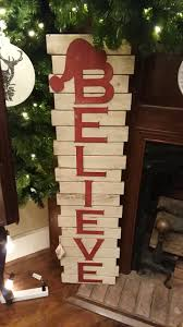 wooden believe sign has white background with red letters measured