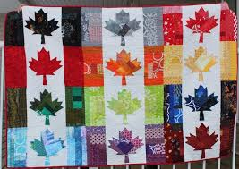quilters | Frankenstein's Fabrics & This Rainbow Canadian flag quilt was sewn with a pattern by Cheryl Arkison  and was given to a Candadian soldier with (PTSD). Adamdwight.com