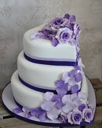 Three Tiered Heart Shaped Wedding Cake With Cascading Roses And