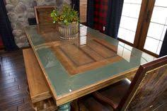 two toned dinning room table made from an old door we found in our farm house perfect door table around the house door tables