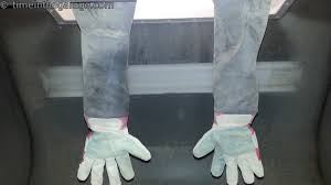 home made sandblasting cabinet gloves made out of gloves from the general farm fleet and some vinyl upholstery material