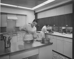 office test. Two Women In The JWT Chicago Office Test Kitchen. One Is Icing A Cake, T