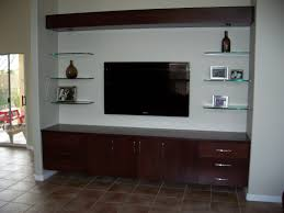 brown wooden wall mounted media cabinet with storage and drawer plus glass shelf hanging on white painted as well modern consoles units cabinets tv