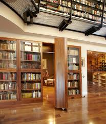 hilltop house inspiration for a large contemporary family room remodel in new york with a library bookcase book shelf library bookshelf read office