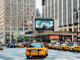 traffic taxis outside madison square garden entrance on 7th avenue manhattan new