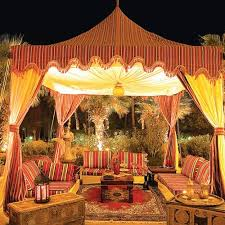 ... Outdoor home decorating with Moroccan fabrics and upholstered  furniture, canopy tent ...