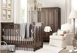 rustic baby girl nursery ideas equipped with dark brown crib grey per pad big wardrobe white single sofa stand lamp on rug along chandelier complete bedding