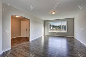 empty rambler home interior with grey walls paint color and laminate floor view of the
