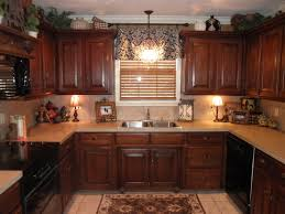 Over Kitchen Sink Lighting The Light Gray Kitchen Cabinets Are Adorned With Extra Long Satin