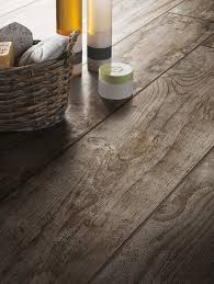 these rustic wood look tiles from the daltile season wood tile collection in autumn wood will fool everyone into thinking your floor is made of reclaimed
