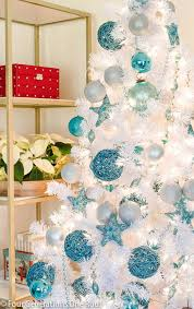 Sharing our budget friendly blue + white Christmas tree full of glittered  ornaments and blue beaded