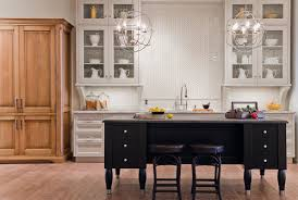 i would say this is the most popular and safe way to go eclectic english country style kitchens with hip orb chandeliers marry industrial with an elegant