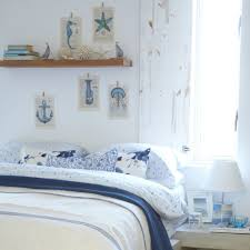 beach themed bedroom with fresh linens
