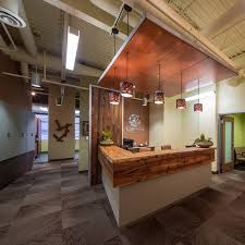 dental office reception. Sustainable Dental Office Utilizing Reclaimed Wood As A Reception Desk And Artwork. M