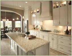 pearl granite with white kitchen cabinets dark gray countertops