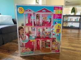 4 reasons to love the barbie dreamhouse