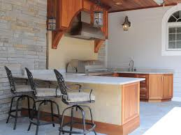 traditional outdoor kitchen with bar