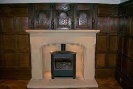 stone fire surround with round arch in oak