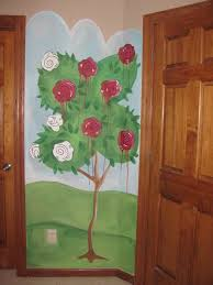 painting the roses red alice in wonderland mural painted in a friends little girls room