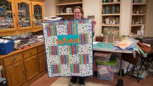 Cancer patient's mom turned to quilt-making to cope, then to... & Branden Camp Mary Stevens holds a quilt ... Adamdwight.com