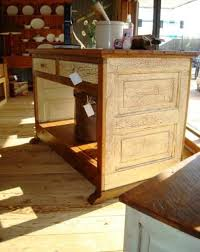 kitchen island made from old barn wood and an old door how chic is this