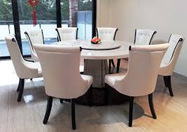 marble top round dining table arrangement
