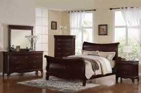 Dark wood sleigh bed