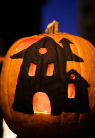 i started the painting idea with this haunted house pumpkin inspired by one i saw on from pas and here they are lit up for the