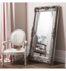 leaner mirror with grey frame on wooden floor plus chair for living room decor ideas antique dresser framed leaning mirror shabby chic