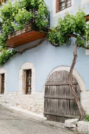 Get ready for your travels. Greece Makedonia Thraki Theologos Wine On House Wall Road Europe Stock Photo 199822746