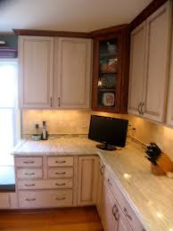 cherry maple cabinets ambroisa white granite tile backsplash with glass accent traditional kitchen
