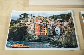a photo of a brightly colored coastal town resting on a wooden board how