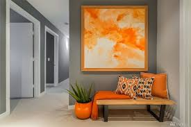 3 tags Modern Entryway with Carpet, High ceiling, George Nelson Slat Bench,  Surya Turner Orange