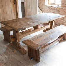 rustic wood dining table with benches