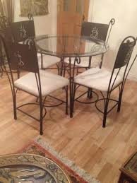 wrought iron glass round cafe style dining table and 4 chairs