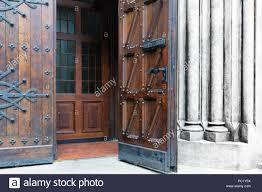 the open old wooden door with metal forging in meval castle